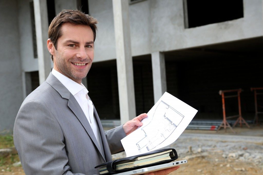 real estate agent holding a document