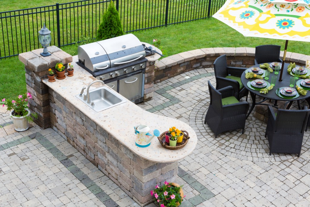 Patio with grill and outdoor dining set