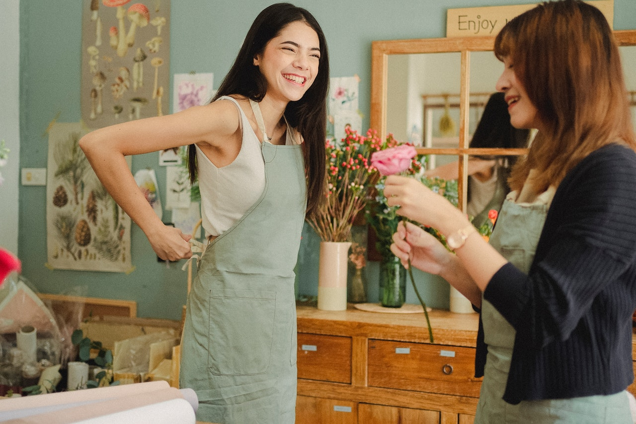 two women with aprons