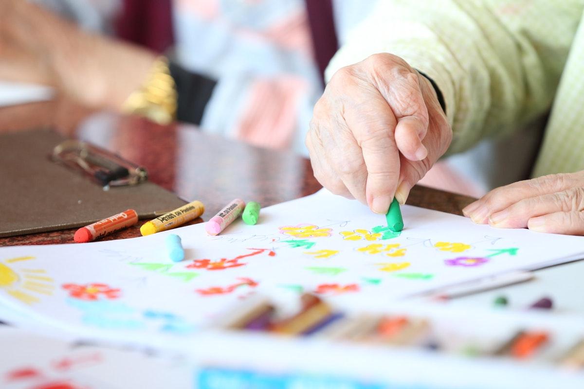elder using crayons