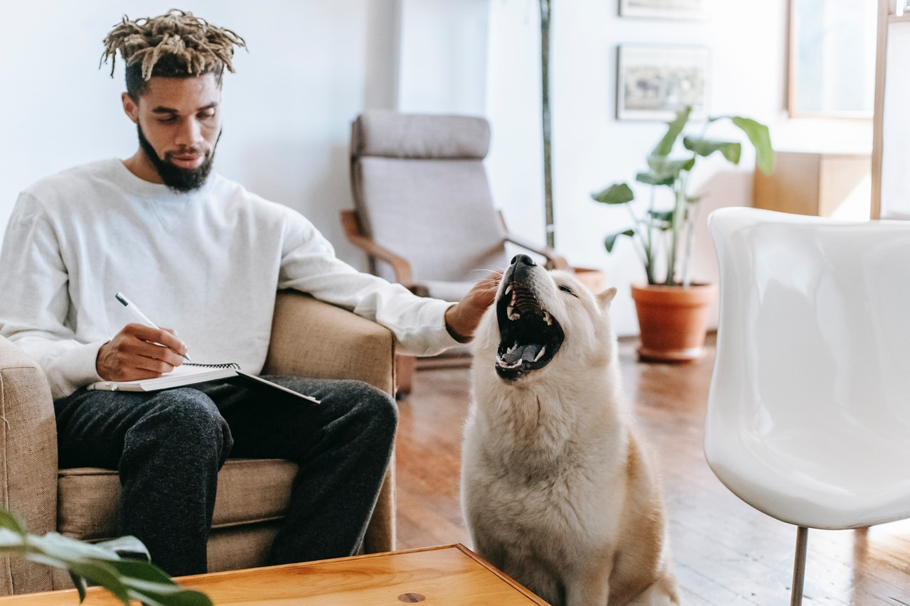 man at home with his dog