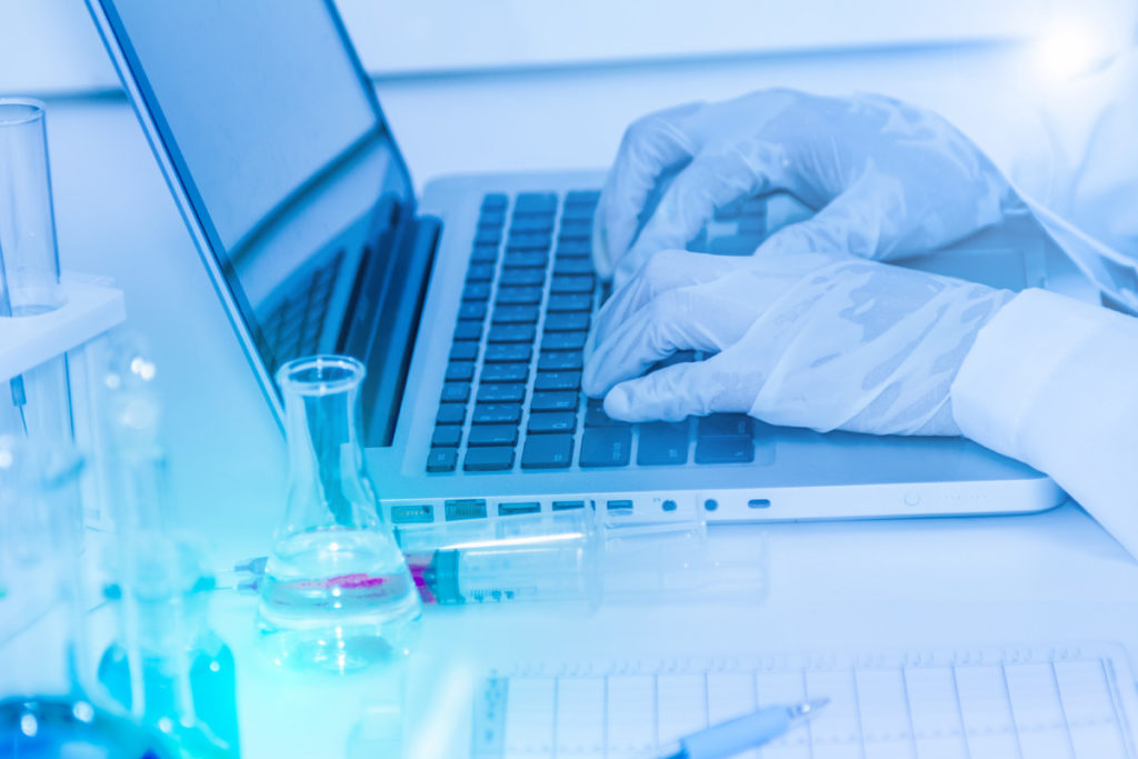 scientist working on a laptop