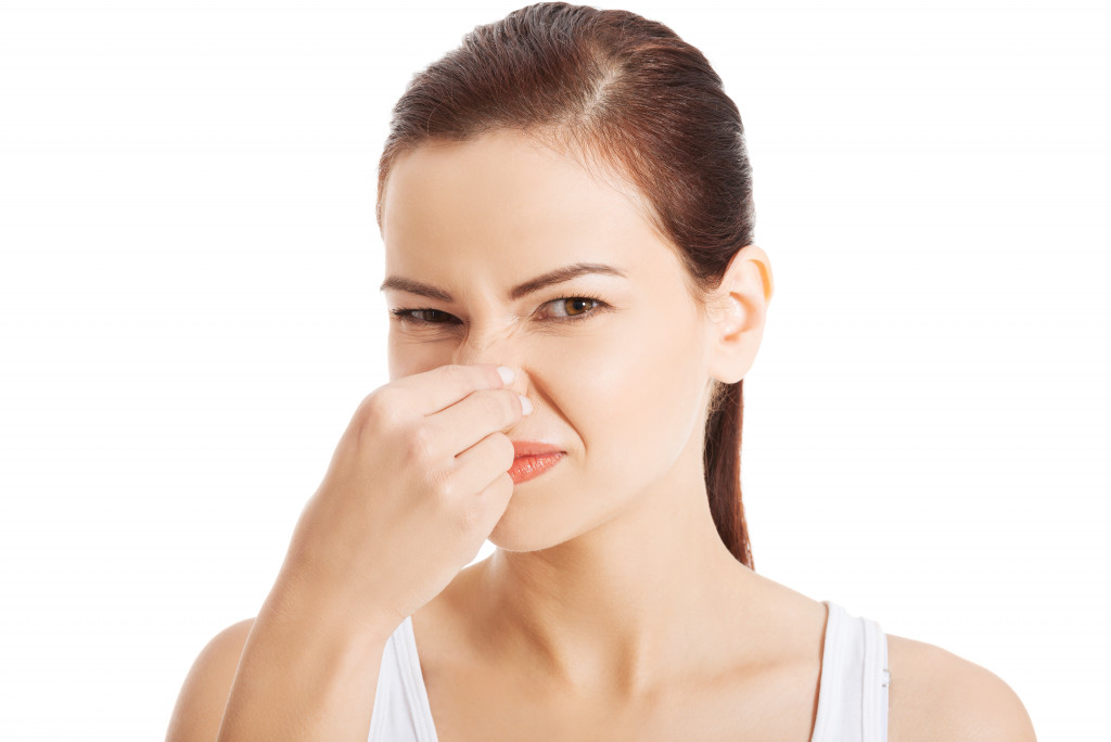 woman covering nose