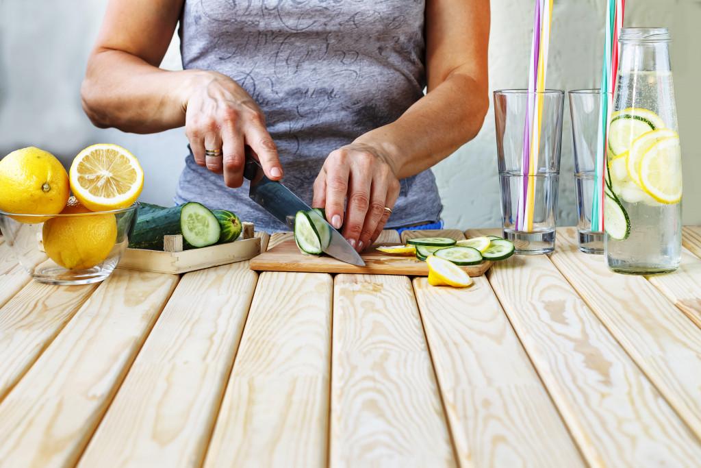 woman cutting fruit