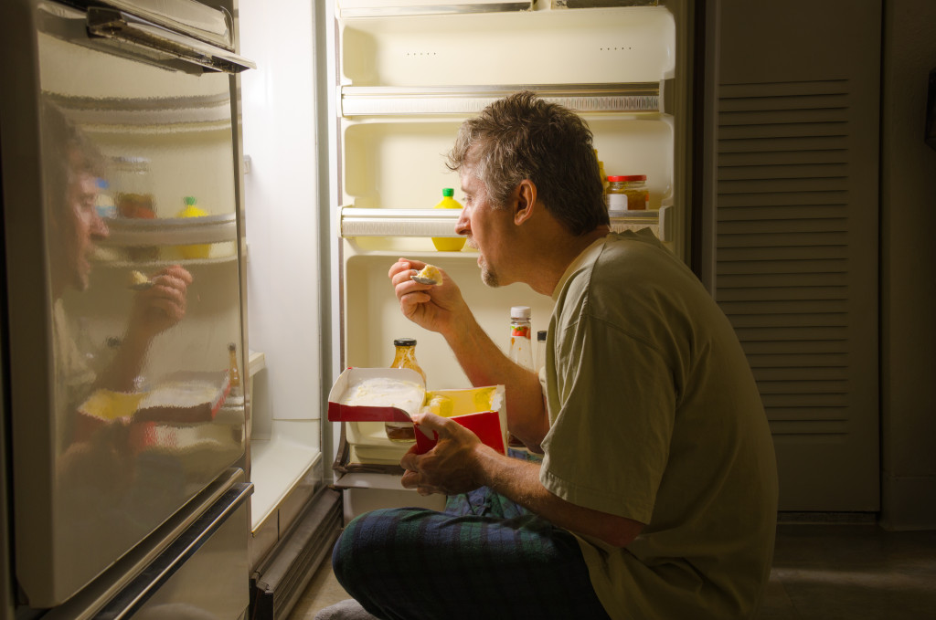 man having a midnight snack