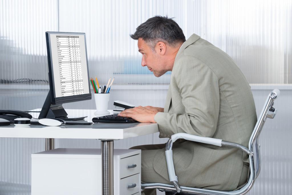 man with bad computer posture