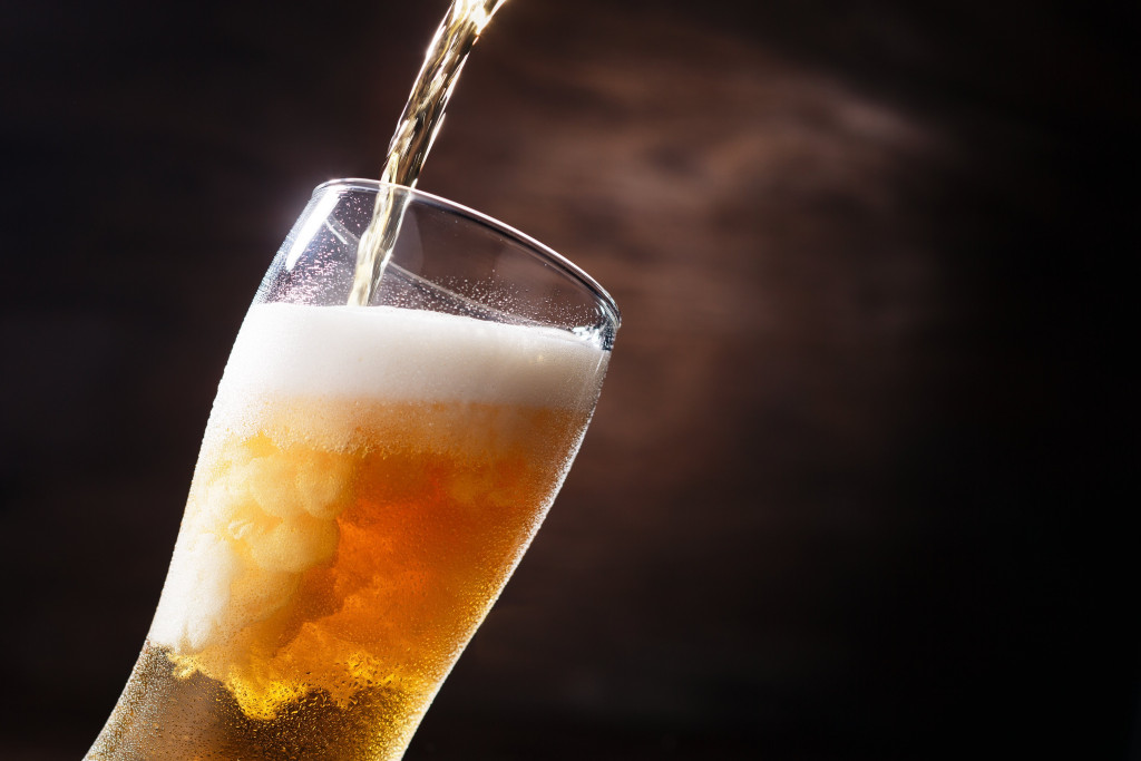 beer being poured in a glass